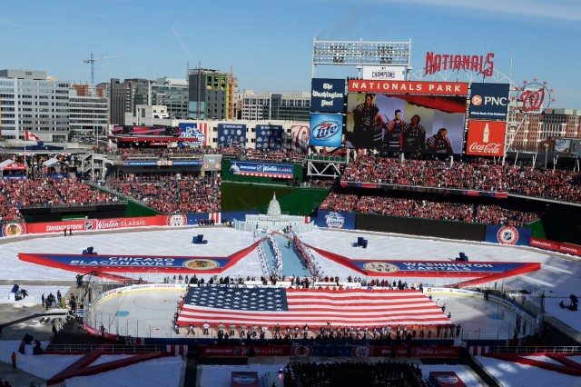 Service members take part in a flag ceremony on the ice in Nationals Park, Washington, D.C., before the start of the 2015 Bridgestone NHL Winter Classic hockey game between the Washington Capitals and Chicago Blackhawks, Jan. 1, 2015. The National Hockey League paid tribute to the U.S. Armed Forces during pre-game and in-game festivities.