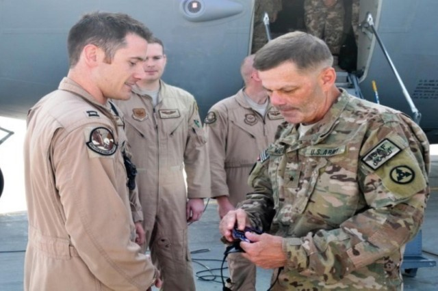Brig. Gen. Donnie Walker Jr., commanding general of the 3rd Expeditionary Sustainment Command, recognizes Capt. Nick Burke, flight commander with the 17th Airlift Squadron, for his efforts in retrograding equipment and maximizing aerial resources, Sept. 25, at Bagram Air Field, Afghanistan.