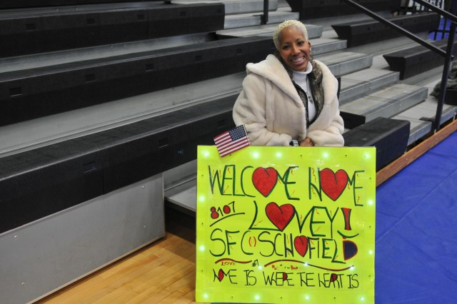 Patrice Dixon-Schofield waits for her husband, Sgt. 1st Class Craig Schofield, during a redeployment ceremony Dec. 20 at Natcher Physical Fitness Center on Fort Knox, Ky. The Sustainers, who were deployed to Kuwait in April 2014, provided critical sustainment support throughout the Middle East; specifically in Iraq as part of Operation Inherent Resolve. (U.S. Army photo by Maj. Jared D. Auchey)