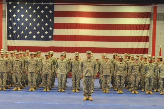 Soldiers from the 3rd Sustainment Command (Expeditionary) wait to be released from formation during their redeployment ceremony Dec. 20 at Natcher Physical Fitness Center on Fort Knox, Ky. The Sustainers, who were deployed to Kuwait in April 2014, provided critical sustainment support throughout the Middle East; specifically in Iraq as part of Operation Inherent Resolve. (U.S. Army photo by Maj. Jared D. Auchey)
