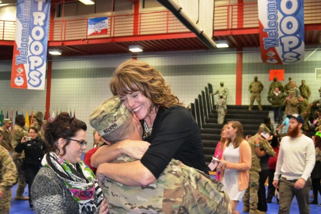 Hope Walker embraces her husband, Brig. Gen. Donnie Walker Jr., 3rd Sustainment Command (Expeditionary) commanding general and a native of Clay County, Ala., during a redeployment ceremony Dec. 6 at Natcher Physical Fitness Center on Fort Knox, Ky. The Sustainers, who were deployed in April 2014 to Afghanistan, were tasked with providing single sustainment mission command in Afghanistan. (U.S. Army photo by Staff Sgt. Justin A. Silvers)