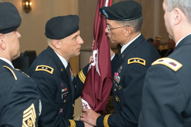 Maj. Gen. Dean G. Sienko, outgoing USAPHC commander, passes the organizational colors to Deputy Surgeon General Maj. Gen. Joseph Caravalho, Jr., signifying his relinquishment of command of the USAPHC in a Jan. 6 ceremony at the Top of the Bay on Aberdeen Proving Ground, Md