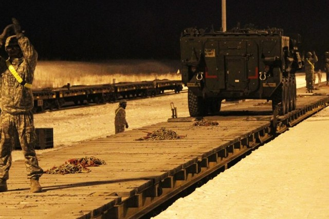 Arctic Wolves Soldiers load flatcars on the Alaska Railroad in December 2014.
