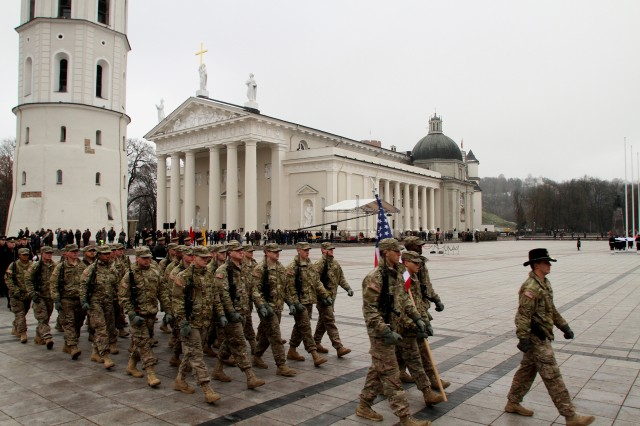 U.S. Soldiers march into the Cathedral Square in Vilnius, Lithuania, for Armed Forces Day, Nov. 23. Soldiers from Company B, 2nd Battalion, 8th Cavalry Regiment, 1st Brigade Combat Team, 1st Cavalry Division, and Soldiers from C Troop, 1st Squadron, 2nd Cavalry Regiment, marched with Danish, Hungarian and Lithuanian Soldiers before crowds of thousands in the Baltic nation's largest city.