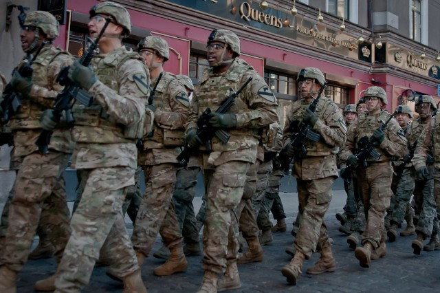 Soldiers from Company A, 2nd Battalion, 8th Cavalry Regiment, 1st Brigade Combat Team, 1st Cavalry Division call cadence as they march through the streets of old Riga, Latvia, as part of the Latvia Day parade that took place, Nov. 18, 2014, to mark the country's 96th year of independence. The Latvian national holiday treated spectators to Latvian, U.S. and other NATO-allied Soldiers performing a pass-in-review for Latvian President Andris B�rzi��, as well as a march to the Freedom Monument in Riga.