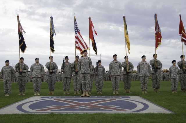 Col. David S. Doyle, center, commander, 2nd Brigade Combat Team, alongside battalion commanders, pose for a photograph on Sexton Field before the brigade's transformation ceremony Oct. 16. The new battalion lineup is, from left, 2nd Battalion, 14th Infantry Regiment; 2nd Battalion, 87th Infantry Regiment; 4th Battalion, 31st Infantry Regiment; 1st Squadron, 89th Cavalry Regiment; 2nd Battalion, 15th Field Artillery Regiment; 41st Brigade Engineer Battalion; and 210th Brigade Support Battalion.