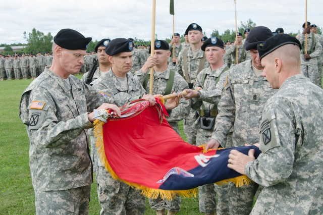 From left, Brig. Gen. Michael L. Howard, 10th Mountain Division (LI) senior acting commander, and Command Sgt. Maj. David Martel, his senior enlisted adviser, help Command Sgt. Maj. Sean Watson, 3rd Brigade Combat Team senior enlisted adviser, and Col. Sam Whitehurst, 3rd BCT commander, furl the Spartan Brigade's guidon during the inactivation ceremony Aug. 14 on Fort Drum's Sexton Field.