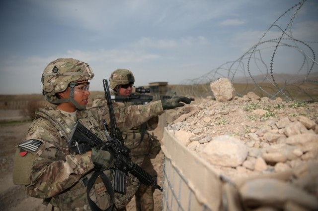 U.S. Army 1st Lt. Audrey Griffith points out an area of interest during a force protection drill to Spc. Heidi Gerke along the perimeter of Forward Operating Base Hadrian in Deh Rawud, Afghanistan, March 18, 2013. Both women are members of the 92nd Engineer Battalion from Fort Stewart, Ga.