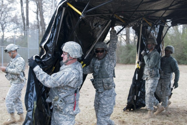 U.S. Army Reserve Soldiers with the 412th Theater Engineer Command's Deployable Command Post One, erects a tent for set up of the tactical operations center during training in Vicksburg, Miss., Jan. 11. (U.S. Army photo by Staff Sgt. Roger Ashley)