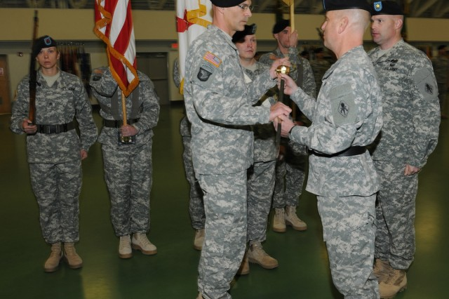 Command Sgt. Maj. Richard Woodring, left, incoming U.S. Army Military Police Regimental command sergeant major, accepts the Noncommissioned Officer's Sword from Brig. Gen. Mark Spindler, USAMPS commandant, during a change of responsibility ceremony held Jan. 8 in Nutter Field House.