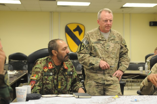 Brig. Gen. Douglas Gabram (right), commander, Train, Advise, Assist Command - South (TAAC-S), speaks alongside Maj. Gen. Abdul Hamid (left), commander, Afghan National Army 205th Hero Corps, at a meeting November 15, 2014. During Gabram's tenure as TAAC-S commander, the two general officers met regularly to discuss ongoing military efforts and issues impacting Afghanistan. (U.S. Army photo/Released).