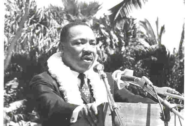Martin Luther King Jr. speaks to a crowd at the University of Hawaii at Manoa's Andrews Amphitheater. King visited UH-Manoa in 1964 to celebrate Civil Rights Week.
