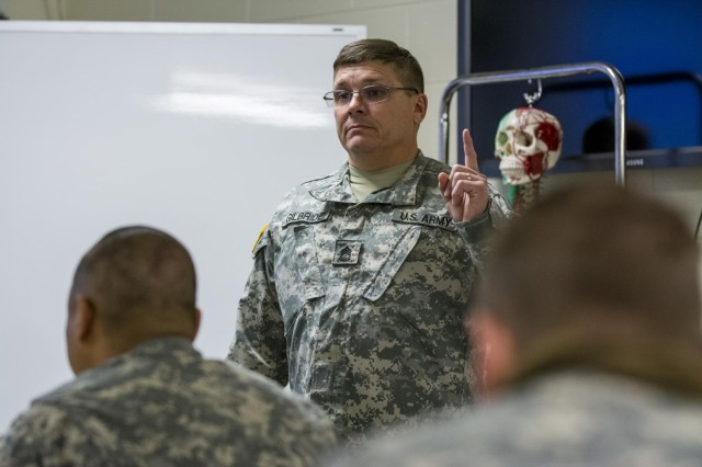 Sgt. 1st Class Leo Gilbride, lead medical instructor for the 204th Regional Training Institute, Idaho National Guard, teaches a class during an 18-day Sapper Advanced Tactical Medical Course to approximately 20 Army medics at Gowen Field Air National Guard Base, Idaho, in January, 2015. (U.S. Army photo by Sgt. 1st Class Michel Sauret)
