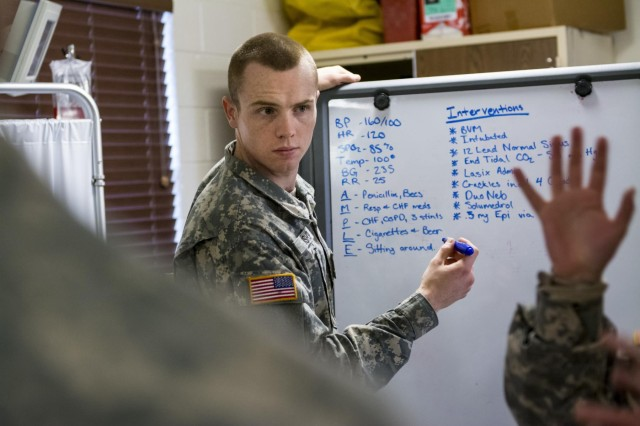Pfc. Chad Bishop, Army Reserve medic with the 321st Engineer Battalion, records notes on a board during a patient analysis exercise as part of an 18-day Sapper Advanced Tactical Medical Course at Gowen Field Air National Guard Base, Idaho, in January, 2015. (U.S. Army photo by Sgt. 1st Class Michel Sauret)