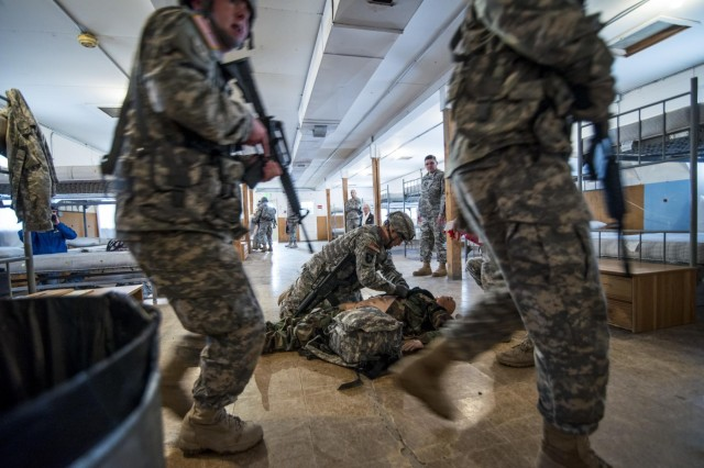 Army Reserve combat engineer medics work to treat casualies during a training scenario as part of an an 18-day Sapper Advanced Tactical Medical Course at Gowen Field Air National Guard Base, Idaho, in January, 2015. (U.S. Army photo by Sgt. 1st Class Michel Sauret)