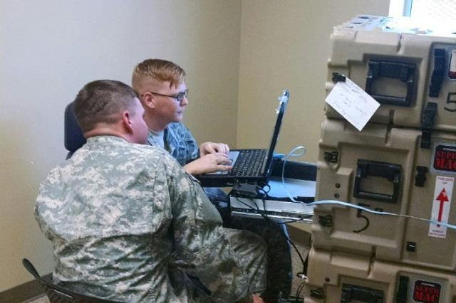 SCHOFIELD BARRACKS, Hawaii - Soldiers of the 25th Infantry Division configure services on the Secure Internet Protocol Router/Network Router Network/Nonsecure Internet Protocol Router. (Photo by Master Sgt. George Sandlin)