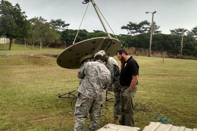 SCHOFIELD BARRACKS, Hawaii - A Soldier assigned to B. Co. 307th Expeditionary Signal Battalion and a soldier assigned to 25th Infantry Division install a SNAP terminal at the Pacific Signal University.