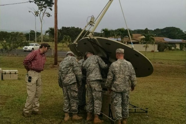 SCHOFIELD BARRACKS, Hawaii - Soldiers assigned to B. Co. 307th Expeditionary Signal Battalion install a SNAP terminal during a class at the Pacific Signal University.