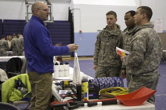 Jim Gamble, safety officer for 2nd Brigade Combat Team, gives helpful winter vehicle safety tips to 2nd BCT Soldiers during a 2nd BCT Deployment Fair on Jan. 13 at Monti Physical Fitness Center, Fort Drum. Many Soldiers who are assigned to the North Country have little experience driving in harsh inclement weather.