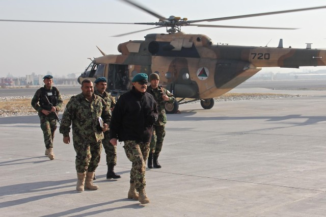 Leaders from the Afghan National Army 203rd Corps arrive to Operational Base Fenty in Afghan Air Force Mi-17 helicopters, Jan. 18, 2015. Corps-level commanders from Afghanistan and Pakistan security forces visited Operational Base Fenty for the first border security cooperation meeting in recent years.