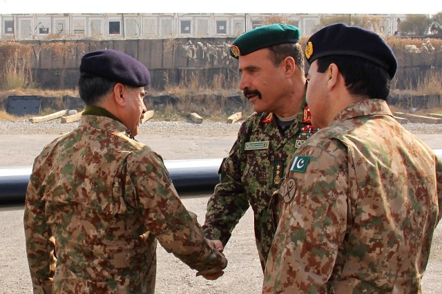 Afghan National army Maj. Gen. Mohammad Zaman Waziri (center), the 201st Corps commander, greets Pakistan army Brig. Gen. Hidayat ur Rehman (left), the 11th Corps commander, following Pakistani military leaders' arrival to Operational Base Fenty, Jan. 18, 2015. Corps-level commanders from Afghanistan and Pakistan security forces visited Operational Base Fenty for the first border security cooperation meeting in recent years.