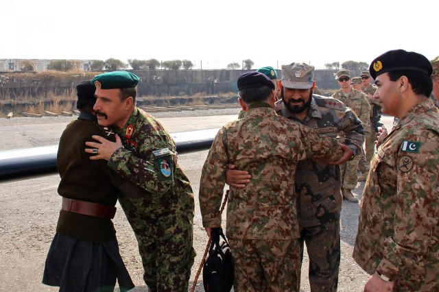 Afghan National army Maj. Gen. Mohammad Zaman Waziri (center left), the 201st Corps commander, greets Pakistan army Maj. Gen. Tayyab Azam (left), the Frontier Corps inspector general, as Afghan Border Police Lt. Gen. Fazluddin Ayar (center right), the ABP Zone 301 commander, greets Pakistan army Lt. Gen. Hidayat ur Rehman (center), the 11th Corps commander, following the Pakistani military leaders' arrival to Operational Base Fenty, Jan. 18, 2015. Corps-level commanders from Afghanistan and Pakistan security forces visited Operational Base Fenty for the first border security cooperation meeting in recent years.