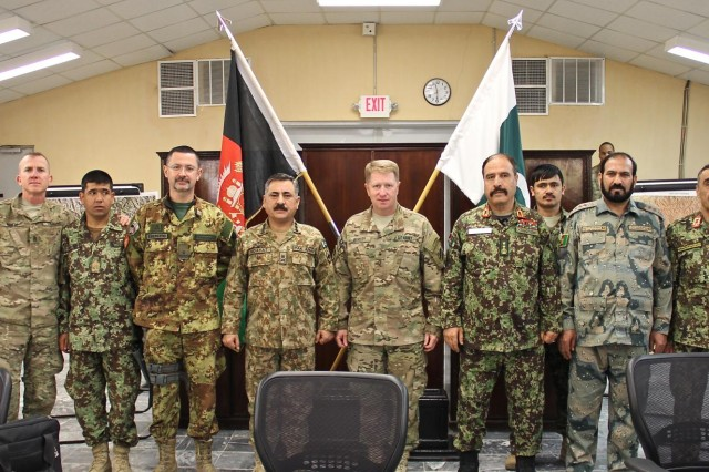 Members of the Afghanistan and Pakistan security forces pose for a group photo with Train, Advise, Assist Command-East and Resolute Support leaders during a meeting at Operational Base Fenty, Jan. 18, 2015. The Afghan and Pakistani military leaders met as part of a new effort to root out terrorism and bring safety and security to the region.