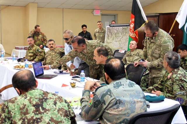 Pakistan army Brig. Inam Haider Malik, the 11th Corps engineer commander, briefs Afghan National army Maj. Gen. Mohammad Zaman Waziri, the 201st Corps commander, on border activities using a graphic on a laptop computer. The Afghan and Pakistani military leaders met, Jan. 18, 2015, at Operational Base Fenty, as part of a new effort to root out terrorism and bring safety and security to the region.