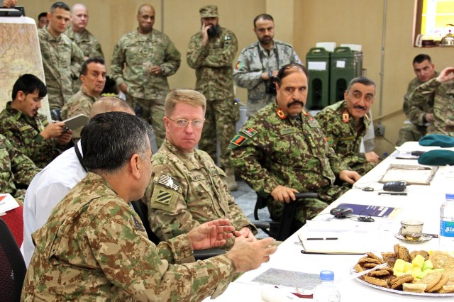 Pakistan army Lt. Gen. Hidayat ur Rehman (left), the 11th Corps commander, talks about military operations near the border with Afghan security forces leaders from the 201st and 203rd Afghan National Army Corps, and Afghan Border Police zones 301 and 402, during a border security cooperation meeting held at Operational Base Fenty, Jan. 18, 2015. Train, Advise, Assist Command-East hosted the event as Afghan and Pakistan security forces begin a new effort to root out terrorism and bring safety and security to the region.