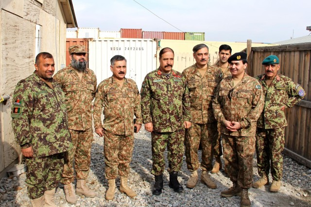 From left to right, Afghan National army Col. Said Mohammad, operations officer for 203rd Corps; Pakistan army Lt. Col. Muhammad Umer Bashir, staff officer for 11th Corps; Pakistan army Lt. Gen. Hidayat ur Rehman, commander of 11th Corps; Afghan National army Maj. Gen. Mohammad Zaman Waziri, commander of 201st Corps; Pakistan army Brig. Gen.Muhammad Nadir Jadoon, a brigade commander in 11th Corps; Pakistan army Brig. Gen. Hassan Khattack, director of military operations for 11th Corps; Pakistan army Brig. Gen. Khaliq-uz-Zaman, senior Pakistan military representative to the Resolute Support Tripartite Joint Operations Center; and Afghan National army Brig. Gen. Mohammad Akbar Youldash, deputy commander of the 203rd Corps pose for a group photo outdoors at Operational Base Fenty Jan. 18, 2015.