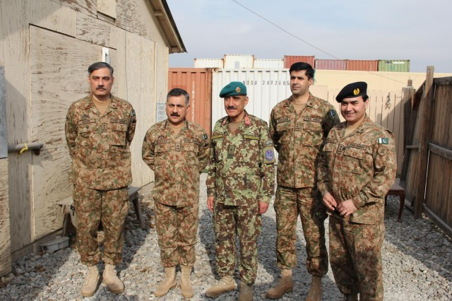From left to right, Pakistan army Brig. Muhammad Nadir Jadoon, a brigade commander in 11th Corps; Pakistan army Lt. Gen. Hedayat ur Rehman, commander of 11th Corps; Afghan National army Brig. Gen. Mohammad Akbar Youldash, deputy commander of the 203rd Corps; Pakistan army Brig. Hassan Khattack, director of military operations for 11th Corps; and Pakistan army Brig. Khaliq-uz-Zaman, senior Pakistan military representative to the Resolute Support Tripartite Joint Operations Center pose for a group photo outdoors at Operational Base Fenty, Jan. 18, 2015.