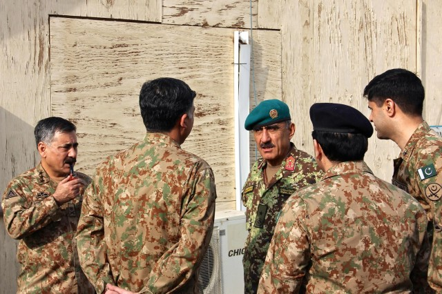 Afghan National army Brig. Gen. Mohammad Akbar Youldash (center), deputy commander of the 203rd Corps, discusses operations of 203rd Corps with Pakistan army leaders during a meeting at Operational Base Fenty, Jan. 18, 2015. Train, Advise, Assist Command-East hosted the event as Afghan and Pakistan security forces begin a new effort to root [removed];out terrorism and bring safety and security to the region.
