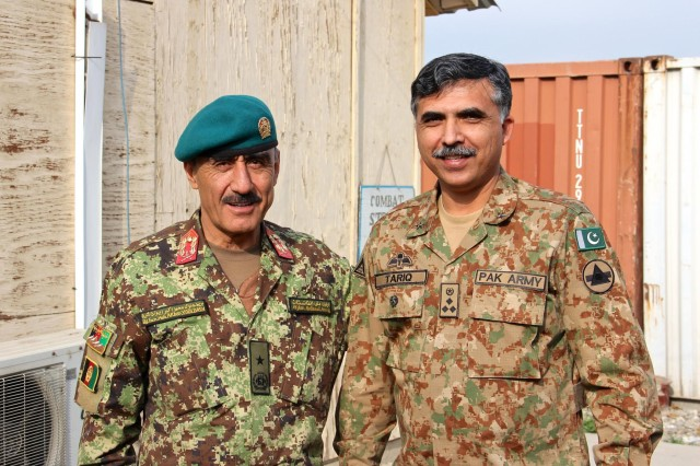 Afghan National army Brig. Gen. Mohammad Akbar Youldash (left), deputy commander of the 203rd Corps, poses for a photo with Pakistan army Brig. Tariq Zameer, a brigade commander in 11th Corps at Operational Base Fenty, Jan. 18, 2015. Members of the Afghanistan and Pakistan security forces came together to discuss challenges on both sides of the border as part of a new effort to root out terrorism, and bring safety and security to the region.