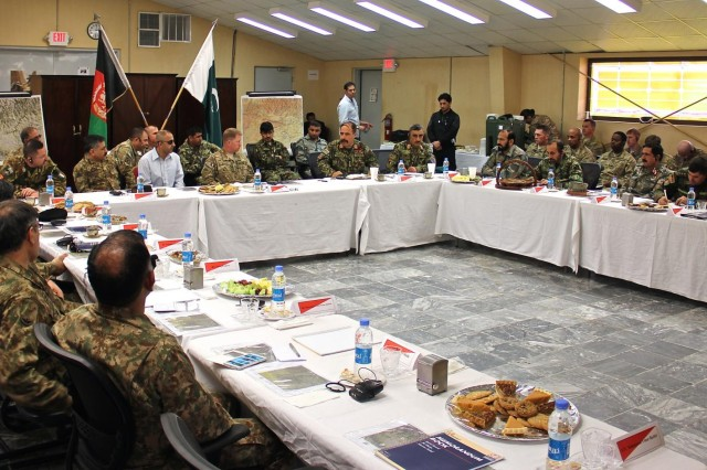 Leaders from corps-level units of the Afghanistan and Pakistan security forces discuss challenges on both sides of the Afghanistan-Pakistan border during a meeting at Operational Base Fenty, Jan. 18, 2015. Train, Advise, Assist Command-East hosted the event as Afghan and Pakistan security forces begin a new effort to root out terrorism, and bring safety and security to the region.