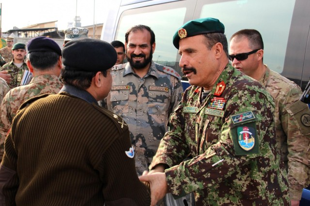 Afghan National army Maj. Gen. Mohammad Zaman Waziri (right), the 201st Corps commander, says goodbye to Pakistan army Maj. Gen. Tayyab Azam (left), the Frontier Corps inspector general, at the conclusion of the meeting between Pakistan and Afghanistan military leaders at Operational Base Fenty, Jan. 18, 2015. Members of the Afghanistan and Pakistan security forces came together to discuss challenges on both sides of the border as part of a new effort to root out terrorism and bring safety and security to the region.