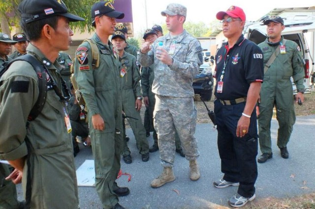 Staff Sgt. Alexander Burdge from the 53rd EOD Company talks through hook and line procedures with his Thai EOD counterparts.