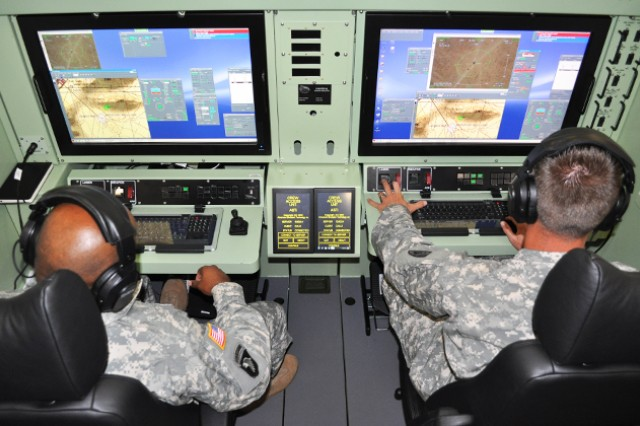 Students from the NCO Academy train in the Universal Mission Simulator.