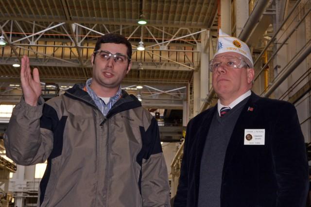 Arsenal Foreman Scott Huber explaining to New York American Legion Department Commander Frank Peters the forging process.