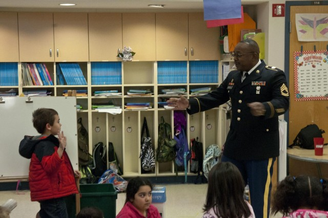 A student at Pelahatchie Elementary School answers a question for U.S. Army Reserve Sgt. 1st Class Darren Mitchell, operations noncommissioned officer with the 412th Theater Engineer Command, during a visit to the school to recognize one of the students Jan. 21. (U.S. Army photo by Staff Sgt. Debralee Best)