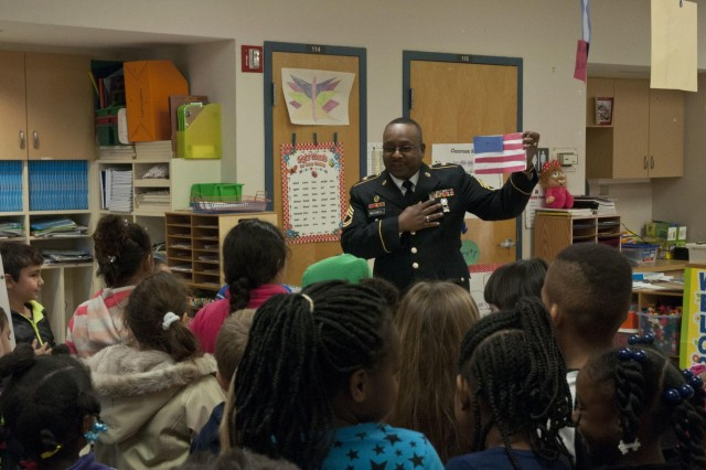U.S. Army Reserve Sgt. 1st Class Darren Mitchell, operations noncommissioned officer with the 412th Theater Engineer Command, speaks with students at Pelahatchie Elementary School during a visit to the school to recognize one of the students Jan. 21. (U.S. Army photo by Staff Sgt. Debralee Best)
