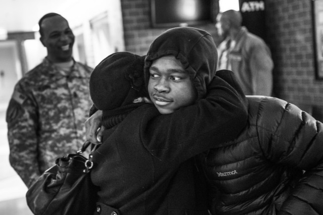 A Chicago teen hugs his mother as they part ways for the weekend for him to attend the Steve Harvey Mentoring Weekend, mentored by U.S. Army Soldiers at Chicago State University during Jan. 23-25. (U.S. Army photo by Sgt. 1st Class Michel Sauret)