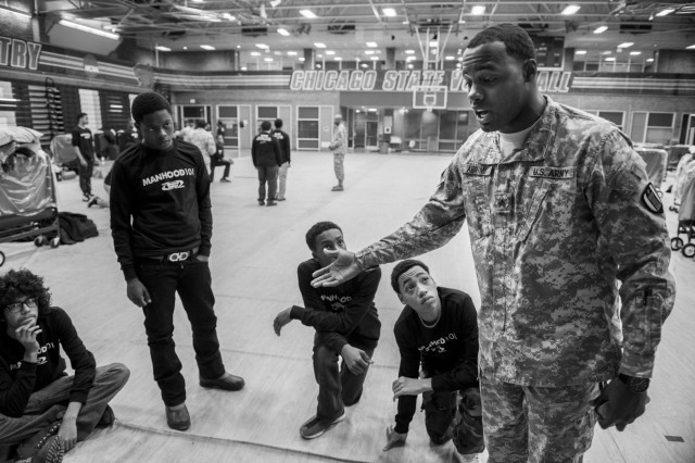 Sgt. Brian Abrams, Army Reserve Soldier with the 863rd Engineer Battalion, talks to his group of Chicago teenagers during the Steve Harvey Mentoring Weekend hosted at Chicago State University the weekend of Jan. 23-25. (U.S. Army photo by Sgt. 1st Class Michel Sauret)