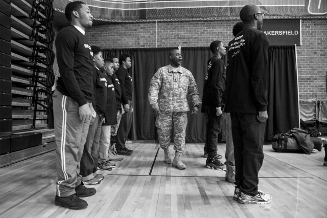 Sgt. 1st Class Michael S. Young Jr., assistant inspector general for the 416th Theater Engineer Command, teaches a group of Chicago teenagers how to do military facing movements during the Steve Harvey Mentoring Weekend hosted at Chicago State University the weekend of Jan. 23-25. (U.S. Army photo by Sgt. 1st Class Michel Sauret)