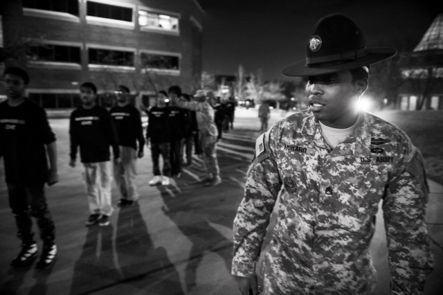 Staff Sgt. Dennis Howard, an Army Reserve drill instructor with the 2-330th Infantry Battalion, One Station Unit Training, leads a march of Chicago teenagers during the Steve Harvey Mentoring Weekend hosted at Chicago State University the weekend of Jan. 23-25. (U.S. Army photo by Sgt. 1st Class Michel Sauret)