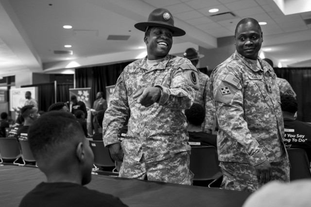 Staff Sgt. Dennis Howard, an Army Reserve drill instructor with the 2-330th Infantry Battalion, One Station Unit Training, and Sgt. 1st Class Michael S. Young Jr., an assistant inspector general for the 416th Theater Engineer Command, joke with a Chicago teenager during the Steve Harvey Mentoring Weekend hosted at Chicago State University the weekend of Jan. 23-25. (U.S. Army photo by Sgt. 1st Class Michel Sauret)