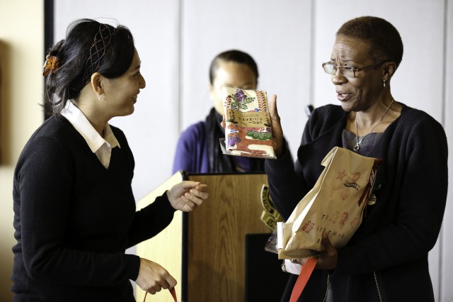 Cynthia Walcott, Supervisory Budget Analyst, USAG -- Okinawa, receives a token of appreciation from her staff Jan. 23 during her farewell at Torii Station.