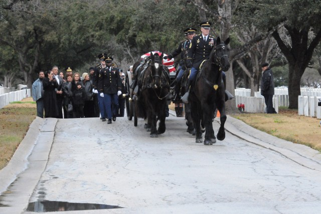 FORT SAM HOUSTON, Texas -- The Fort Sam Houston Caisson Section and Honor Guard Platoon brings Army Sgt. Gilberto Sanchez to his final resting place Jan. 23 at the Fort Sam Houston National Cemetery. A memorial service was held for Sanchez earlier in the day in his hometown of New Braunfels, Texas.