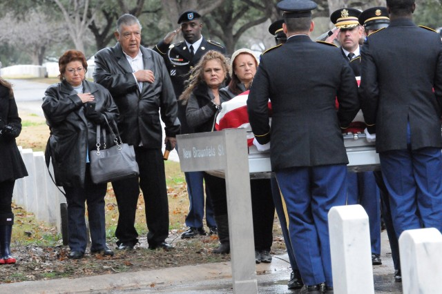 FORT SAM HOUSTON, Texas -- The family of Army Sgt. Gilberto Sanchez pay their respects as members of the Fort Sam Houston Caisson Section carry him to the caisson wagon Jan. 23 at the Fort Sam Houston National Cemetery. Sanchez was finally laid to rest after he disappeared in December 1950 during the battle of Chosin Reservoir.