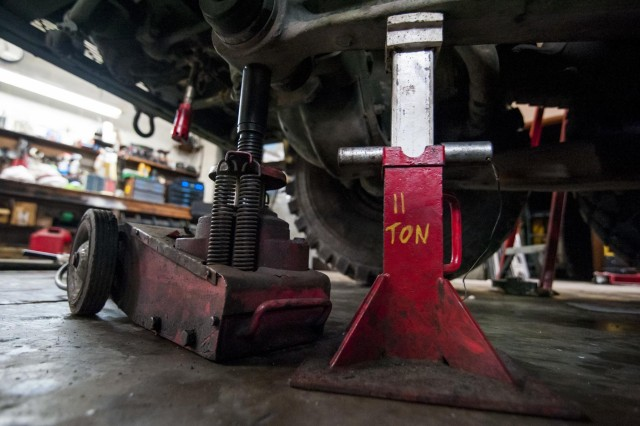 An hydraulic jack and stand hold up 55,000 pounds of weight from an Army Reserve M1142 Tactical Fire Fighting Truck at a Chicago-based firetruck maintenance facility Dec. 22. (U.S. Army photo by Sgt. 1st Class Michel Sauret)