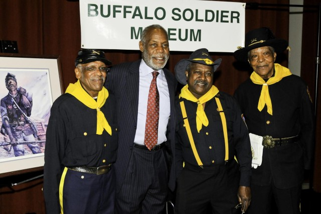 Actor, producer and humanitarian Danny Glover poses with Buffalo Soldier veterans of the 9th Cavalry at the meet and greet portion of the Honoring the Past and Embracing the Future, an American history tribute to the Buffalo Soldiers at Tacoma, Wash., Jan. 25.